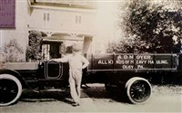 : Amandus D. Moyer and one of the original delivery trucks!